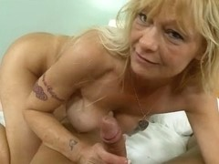 Sexy blonde does handjob and blowjob in porn video