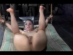 Buxom brunette enjoys a lezdom BDSM fun