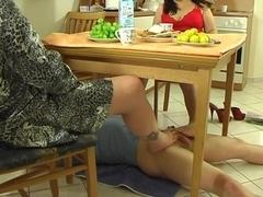 Footjob underneath the table