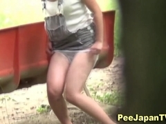 Asian chick ###s outdoors in rain