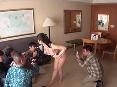 Horny Japanese skank spreads her legs for these freaks