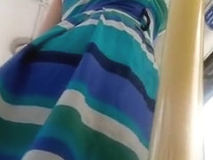 Woman in colorful dress upskirted