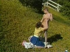 Retro lesbian sluts have sexy fun in a public garden