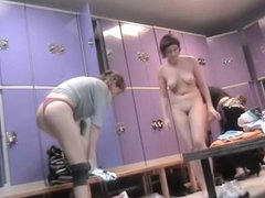 Fat woman in the changing room has beautiful naked boobs