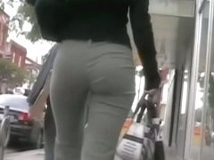 Brunette with a fine ass works it before a candid street cam