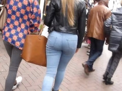 Candid blonde teen with sexy curves in jeans