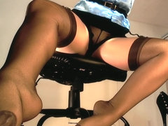 Underdesk tease showing nylons over stockings