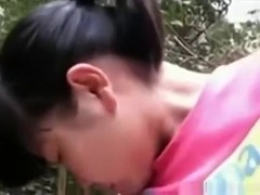 Cute asian girl makes a sextape with her bf in the forest