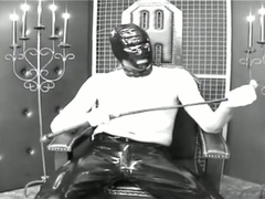 Latex slave gets her big tits tortured and fondled