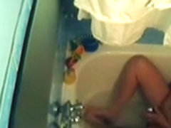 Wife in the baths tub masturbating on hidden web camera clip