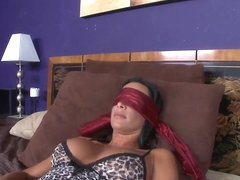 The blindfolded milf Lezley Zen gets dick in mouth