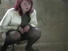 Remarkable milf caught while pissing