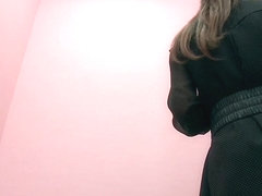 Sexy Asian poses in lingerie before dressing room spy cam