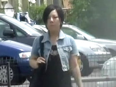 Black-haired petite Asian hoe flashes her bushy pussy during street sharking