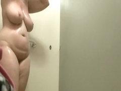 Chubby tattooed woman showers