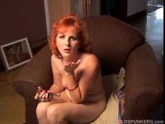 Glamorous ginger cougar talks indecent and copulates her soaked fur pie
