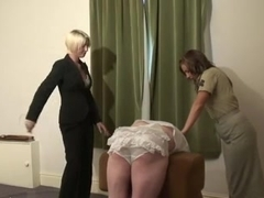 Caned and strapped in frilly panties