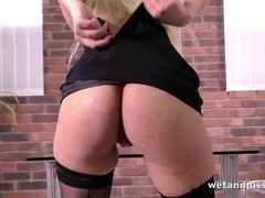 Stunning blonde lady in stockings drilling her ass