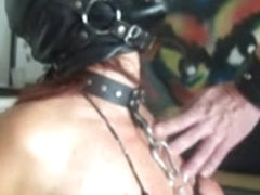 Masked babe with tortured breasts sucks a big dick