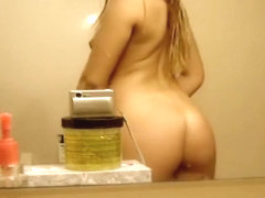 Nude blonde model posing solo