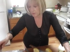 Mature lady spied while baking muffins