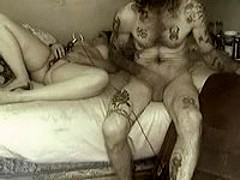 Tattooed bloke owns chick