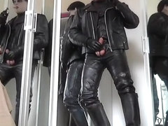 leather biker rubber masked vampire smoke