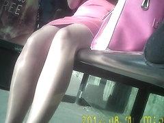 Sexy shiny tan pantyhose girl in bus stop