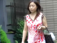 Asian lady unfortunately got involved in boob sharking.