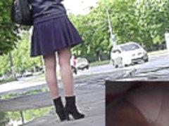 Upskirt panty shots of the blonde girl in black skirt