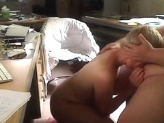 Short haired blonde milf gives her fat husband a blowjob on his office chair