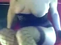 Blonde with fishnet stockings play with two sexy toys