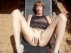 My wife fingers her snatch outdoors