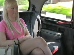 Busty blonde amateur giving head in fake taxi
