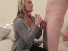 Clothed milf tugs big cock