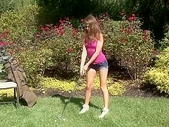 Cute Girl Plays Golf