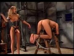 Leggy blonde mistress tortures her slave