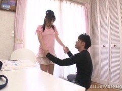 Busty Tokyo teen performs a very arousing blowjob session