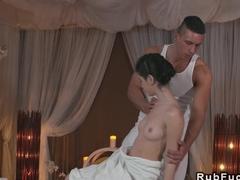 Oiled brunette banged by her masseur till ass jizz