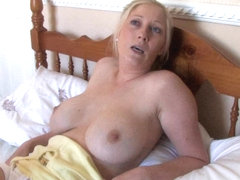 Beautiful blonde shows off in free down blouse video