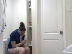 Chubby girl in glasses taking a long pee
