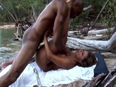 Esperanza Gomez bonks outdoors with a dark boy