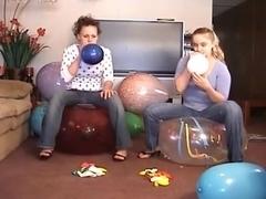 2 Girls Popping Balloons