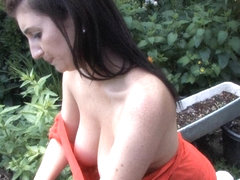 Big plump tits in the garden in a free down blouse video