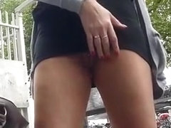 Exhibitionist flashes pierced pussy