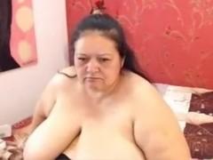 Fat granny Flavia teases with her super big tits