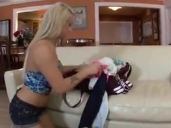 Blonde girls eat each other out in the couch