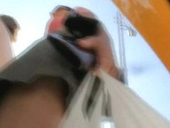 Upskirt voyeur video of a brunette milf
