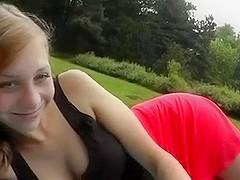 In a park, in public