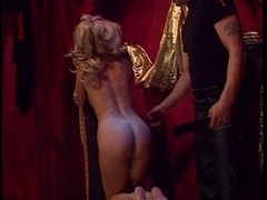 Breasty golden-haired restrained and has arse spanked